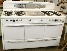 Roper 1949 Town & Country gas range with lots of ovens & broilers all with scientific charts inside the doors.