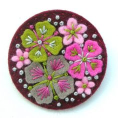 10 SUMMER RAIN FELT BROOCH PINS WITH FREEFORM EMBROIDERY  I have individually designed and hand crafted each pin - they measure 5cm in diameter.