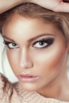 Make your lashes appear longer by drawing black shadow upward and out, creating a triangle shape.
