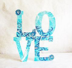wooden letters covered with paper or fabric