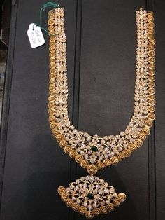 Stunning gold necklace with lakshmi devi kasu hangigns. Necklace studded with uncut diamonds. 29 May 2018 Gold Earrings Designs, Beaded Jewelry Designs, Gold Jewellery Design, Gold Jewelry, Gold Necklace, Designer Jewellery, India Jewelry, Temple Jewellery, Bridal Jewellery