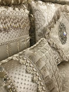 The Exquisite Luxury Bedding by Reilly-Chance Collection. The pillows are adorned with beads,tassel fringe and Swarovski Crystal covered embellishments. Like a fine piece of jewelry, the fabrics and trims in this bedding collection shimmer in different shades from any angle. (Samples are available at no charge if you would like to confirm the colors in your own room!)