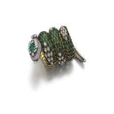 Emerald, enamel and diamond bracelet-watch, 'Dragon', Bulgari 1960s - The articulated body composed of green enameled scale-like links, further highlighted with marquise-shaped diamonds, the head and tail pavé-set with brilliant-cut, marquise- and pear-shaped diamonds, the eyes accented with cabochon rubies, the head further embellished with a pear-shaped emerald and opening to reveal a circular watch, the dial signed Jaeger - LeCoultre, the bezel set with single-cut diamonds - Signed…