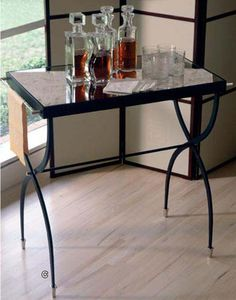 A classic Butlers Table for displaying your favorite spirits and glassware. | cort.com