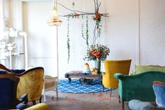 Vintage furniture and fresh flowers combine to create a Blue and Orange Wedding Inspiration