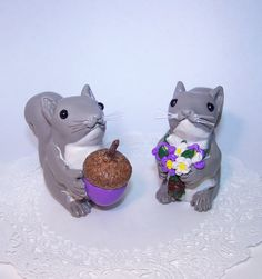 Hand sculpted.    These adorable Love Squirrels are so darling with their matching colored acron and bouquet. So cute ... to be enjoyed for a