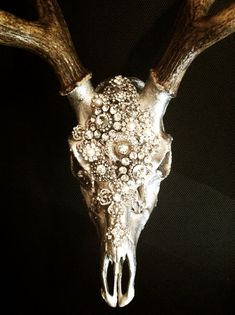 Finally a deer head worth mounting! Embellished deer skull by MolliePDesigns on Etsy. I could so do this with Bruce's deer skull.