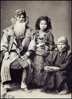AINU GRANDPARENTS AND THEIR GRAND-DAUGHTER -- The Original Inhabitants of OLD JAPAN  I love the wild and free look of the young girl. Grandpa has a sword. The integration of the cultures was inevitable, and the approximate form of the Japanese Kimono has already been adopted.  Photo- Okinawa Soba