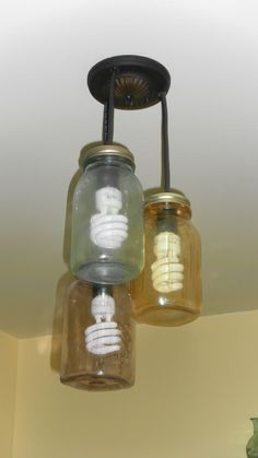 Mason Jar light fixture we made for our kitchen...really don't like the look of flourescent bulbs in these