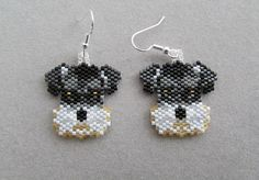 These adorable beaded Schnauzer earrings measure 1-1/8 inches wide and 1-3/8 inches long, excluding the ear wires. I have used brick-stitch and approximately 588 tiny delica beads, intricately woven together, one bead at a time, with a beading needle and beading thread to create the finished earrings you see here.  They would make a great gift for any dog lover, especially a Schnauzer owner, or maybe even a gift for yourself!  The pierced fishhook ear wires are silver plated surgical steel…