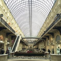 """""""Inside GUM in the Red Square. It's the most enormous shopping mall I've ever experienced. It was built in the 18th century, and the spectacular arc was added later."""""""