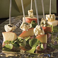 These starters look elegant on a serving platter--guests will be fooled by how quick and easy they really are. Assemble up to one hour ahead, cover with damp paper towels, and chill. Serve coarse-grain mustard or chutney alongside the skewers.Recipe:Ham-and-Cheese Skewers