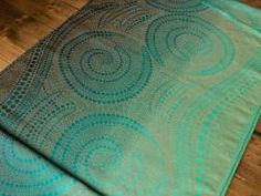 Skipping Stones Ripple Baby Wrap designed by Elizabeth Close for Oscha Slings. Hemp and Organic Cotton.