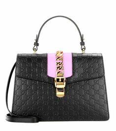 Signature Sylvie embossed leather shoulder bag | Gucci