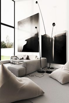 A little too cold for my taste but I love the wall art and simple furnishings of this minimal, modern living room.
