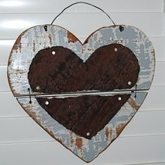 Love Heart: Handmade One Of A Kind Rustic Wood & Rusty Metal Valentine Old Weathered Wood Jointed Heart with Rusted Tin Heart Attached. $24.00, via Etsy.