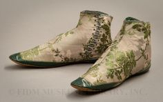 Evening boots  1850-55    Pair of bright blue satin high shoes  French, 1865       Woman's shoes  Italian (Florence), 1818
