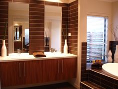 Wide tiles and smooth lines give this bathroom a modern edge.