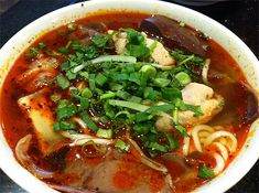 Bun Bo Hue, Vietnamese spicy noodle soup, Vietnamese food from Central Vietnam, noodle soup with beef and pork