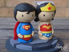Cute Superhero Wedding Cake Topper - Superman and Wonder Woman; want this but with wolverine instead of superman :)