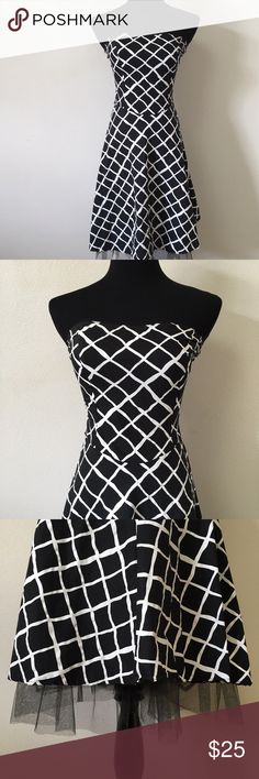 Black & White Criss Cross Strapless A-line Dress Lovely cotton and spandex a-line strapless dress. It is a junior's size 5, has a black and white criss cross pattern, and tulle lining the bottom hem to give it some fluff. Dresses Midi