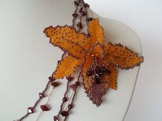 Orchid Flower Garnet Necklace by Milenas Boutique, $158