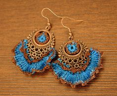 Blue crocheted earrings by Julia Kolbaskina, via Flickr