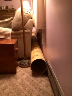 Creating a tunnel behind the couch (when the couch is under a window) to keep bunnies from getting behind/under it, but still allowing curtains to move.
