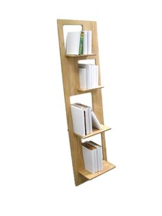 A simple and functional plywood shelf that leans against a wall for stability  Cut from a rectangle of material, the shelves, once slotted in place leave the voids they have been cut from for books and objects.   Gravity rests the shelves to a level position in each slot, and once pushed through to contact the wall and wedged in place, the shelves act as a brace to stop the unit flexing.   Dimensions are for the assembled shelf.