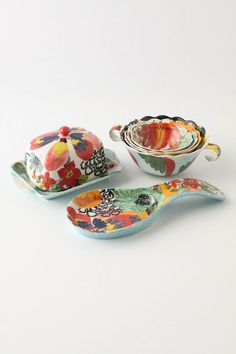 Want it all. Painted Amaryllis Spoon Rest - butter dish- measuring cups. Anthropologie.com