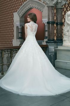 Alencon and Venice lace tulle ball gown features a Queen Anne neckline and basque waistline. Justin Alexander, 2014