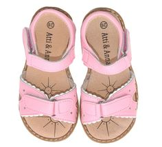 These precious little girls sandals are the height of girliness with their delicate scalloped edging and loveheart cutouts detailing.