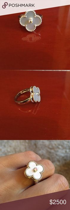 Van Cleef and Arpel Vintage Alhambra ring Worn a few times. Size 4 1/2. 18kt white gold with mother of pearl and diamond in the center. Stunning just no use for it Van Cleef and Arpel Jewelry Rings
