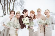 Mismatched Bridesmaid Dresses and Cardigans: This bride went with mismatched taupe dresses. To tie them together they each wore a cute wintery cardigan on top. This keeps your bridal party warm and toasty, but also cohesive.  | Mismatched Winter Bridesmaid Dresses