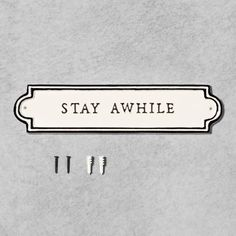 """Make guests feel right at home with this Stay Awhile Wall Sign from Hearth & Hand™ with Magnolia. In cream, this typography wall decor features black text that reads """"Stay Awhile,"""" with black border detailing for a classic look. Stay Awhile Sign, Magnolia Home Decor, Lattice Wall, Welcome Home Signs, Neutral Paint Colors, Gray Paint, Chip And Joanna Gaines, Bathroom Wall Art, Wall Mirror"""