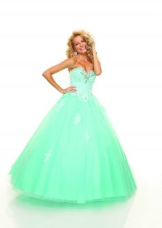 Mint Green Prom Dress!!!! Is it just me or does girl in the dress looks creepy?<<<<<< yes she does a little.