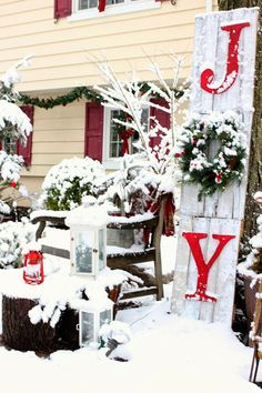 Joy pallet sign and lanterns in snow-www.goldenboysandme.com