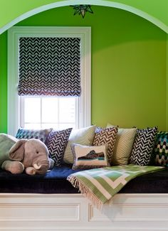 Another sweet little nook in colors that would work in a boy or girls room. For Blain minus the elephant. :)