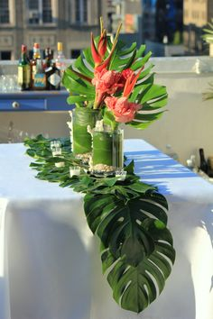 Hawaiian Table Scape by The Smith Society ...New Seasons and Whole Foods often carry these tropical leaves, or DIY it with paper.