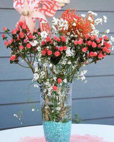 Corals and pinwheels with a splash of teal for a boho inspired wedding centerpiece. Decor by Imprint Affair.  #intimatelyimprint #imprintlc #imprintaffair #eventplanner #wedding #weddinginspiration #centerpieces #flowers #flower #boho #bohochic