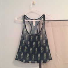 Pineapple Cropped Tank Navy crop tank top with a racer back and cute green pineapples. A nice chiffon material tags are off but never been worn. From the Bethany Mota collection!                                                        I need to get rid of everything ASAP!!!  • I will negotiate to reasonable prices!  • Everything bought today will ship out ASAP  • No hold No trades or swaps  • All sales are final!!! Aeropostale Tops Crop Tops