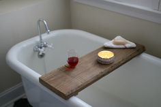 Make this rustic bath caddy — with the added bonus of a built-in wine glass holder — from a single board of reclaimed wood. Use it to relax and bring a true spa feeling to your bathroom.