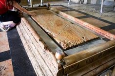 The Stone of the Unction at the Church of the Holy Sepulcher in Jerusalem. (Of course the only religious leader's tomb which is empty! Harry)