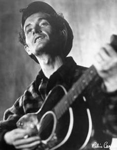 """A folk song is what's wrong and how to fix it or it could be who's hungry and where there mouth is or who's out of work and where the job is or who's broke and where the money is or who's carrying a gun and where the peace is.""  ~ Woody Guthrie     Happy 100th Birthday"