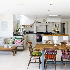 Kitchen Living Room Kitchen diner with white walls, grey sofa, wooden table and colourful chair cushions - Looking for family kitchen design ideas? Choose your family kitchen from our inspirational photo gallery of functional family design kitchen ideas Open Plan Kitchen Dining Living, Open Plan Kitchen Diner, Kitchen Design Open, Open Plan Living, Small Living, Country Kitchen Diner, Kitchen Diner Lounge, Kitchen Family Rooms, Living Room Kitchen