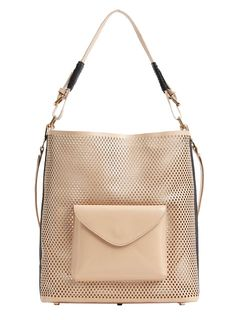 SS14 key trend – eyelet-inspired fashion. Love this #sassandbide handbag.