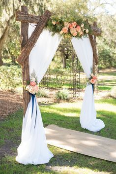 Rustic Wood Ceremony Arch // burlap aisle runner, rustic wedding, summer wedding, greenery, coral florals