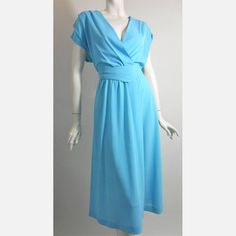 perfect vintage turquoise disco dress that instantly goes from cover-up to day dress with sandals to an evening dress with gold flats, gladiator sandals or kitten heels.
