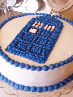 Tardis Cake by ~queen382 on deviantART - I like this way of doing it, so much more damn transportable than what I did and then drove 300 miles.