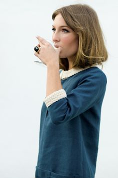 so lovely. that braiding at the neckline and sleeves is very Jackie Kennedy. almost nautical.